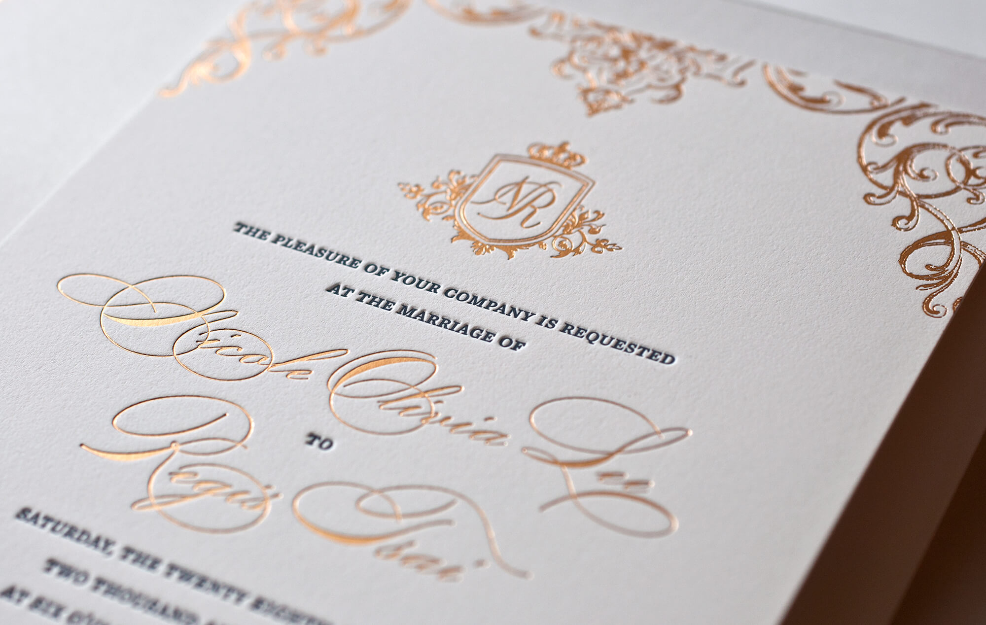 Ornate gold wedding invitation card